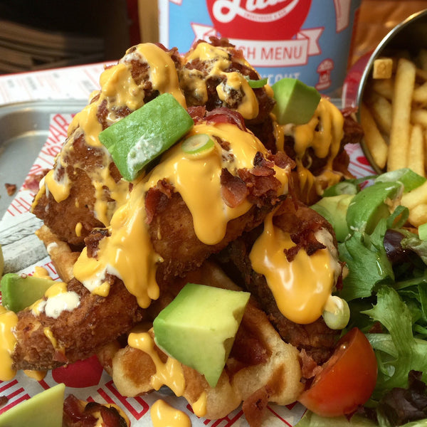 Buttermilk Chicken on Waffles with Avocado and Cheese Sauce