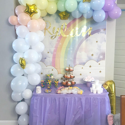 balloon arch with dessert table