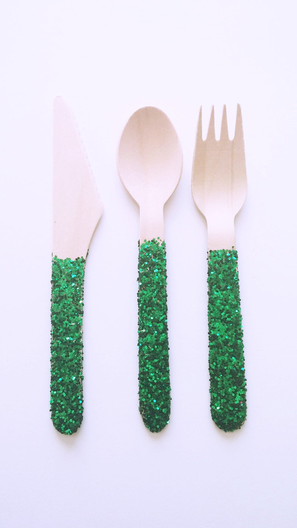 Green glitter wooden forks, spoons and knives for a dinner party