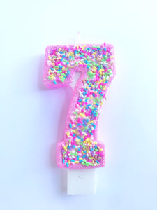 Number 7 ice cream birthday candle with faux sprinkles
