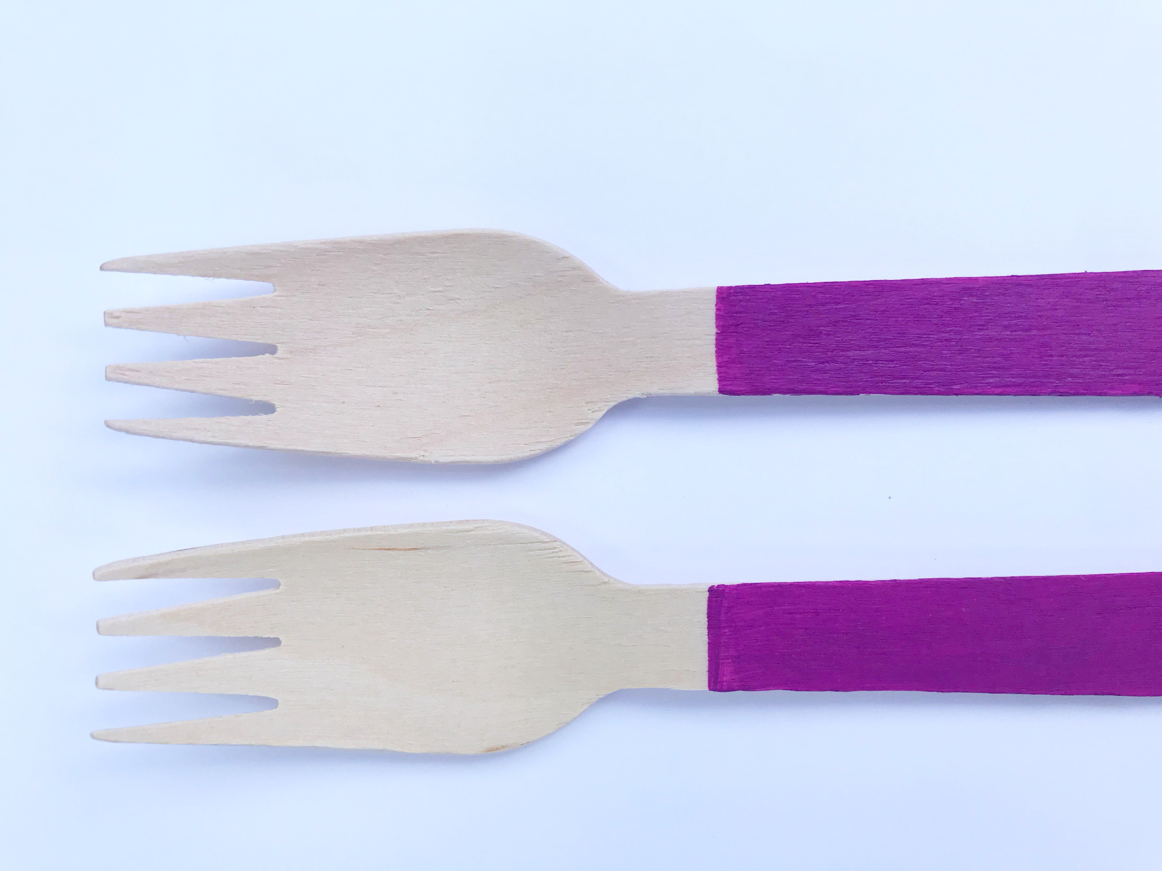 purple painted wooden forks