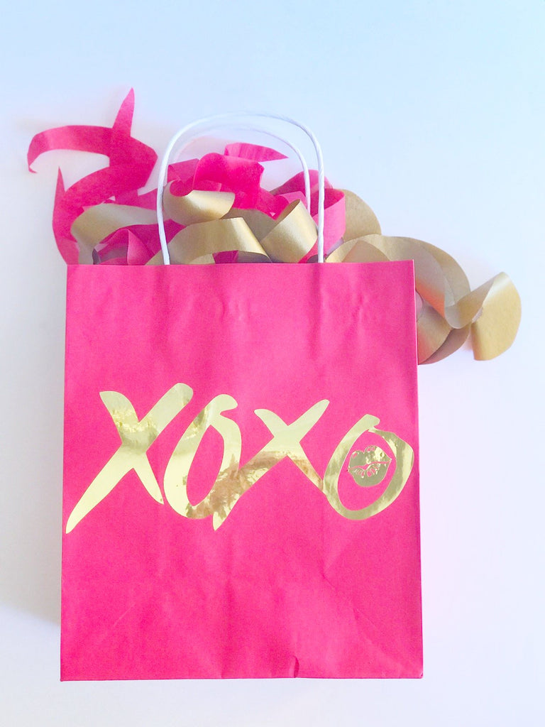 Red paper gift bag hugs and kisses for Valentines Day