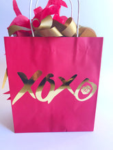 Red paper gift bag for Valentines day party favors