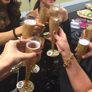 gold plastic champagne glass toast