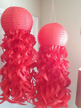 red paper jellyfish lanterns made with 100% recycled fiber