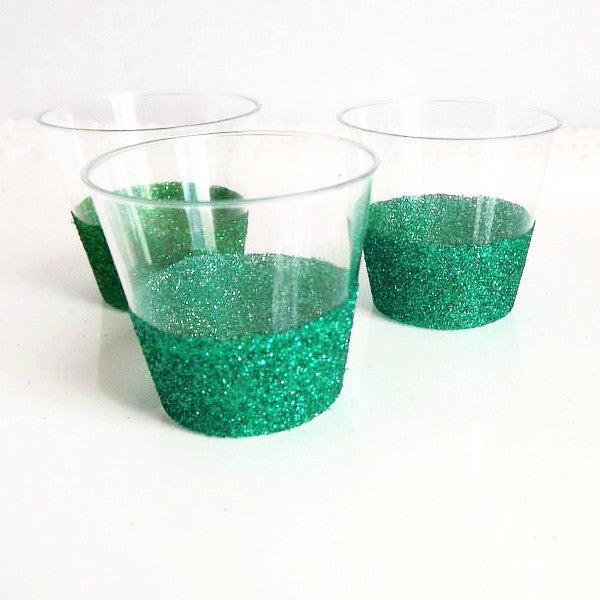 Green glitter plastic shot glasses for parties and events