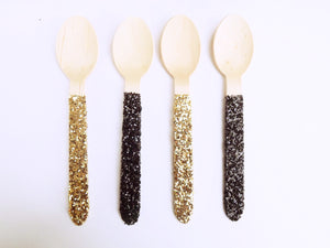 Black and gold wooden spoons