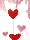 red and pink glitter heart cake toppers