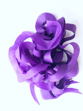 purple curly tissue paper