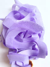 Lavender curly tissue toss made from 100% recycled fibers