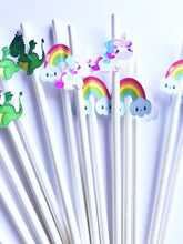 white paper drinking straws for a unicorn and dragon themed birthday party