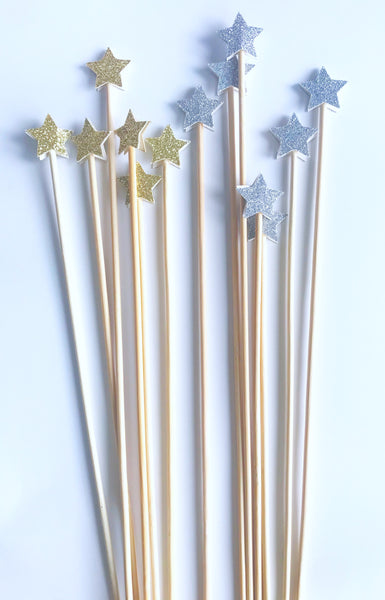 silver and gold star drink stirrers
