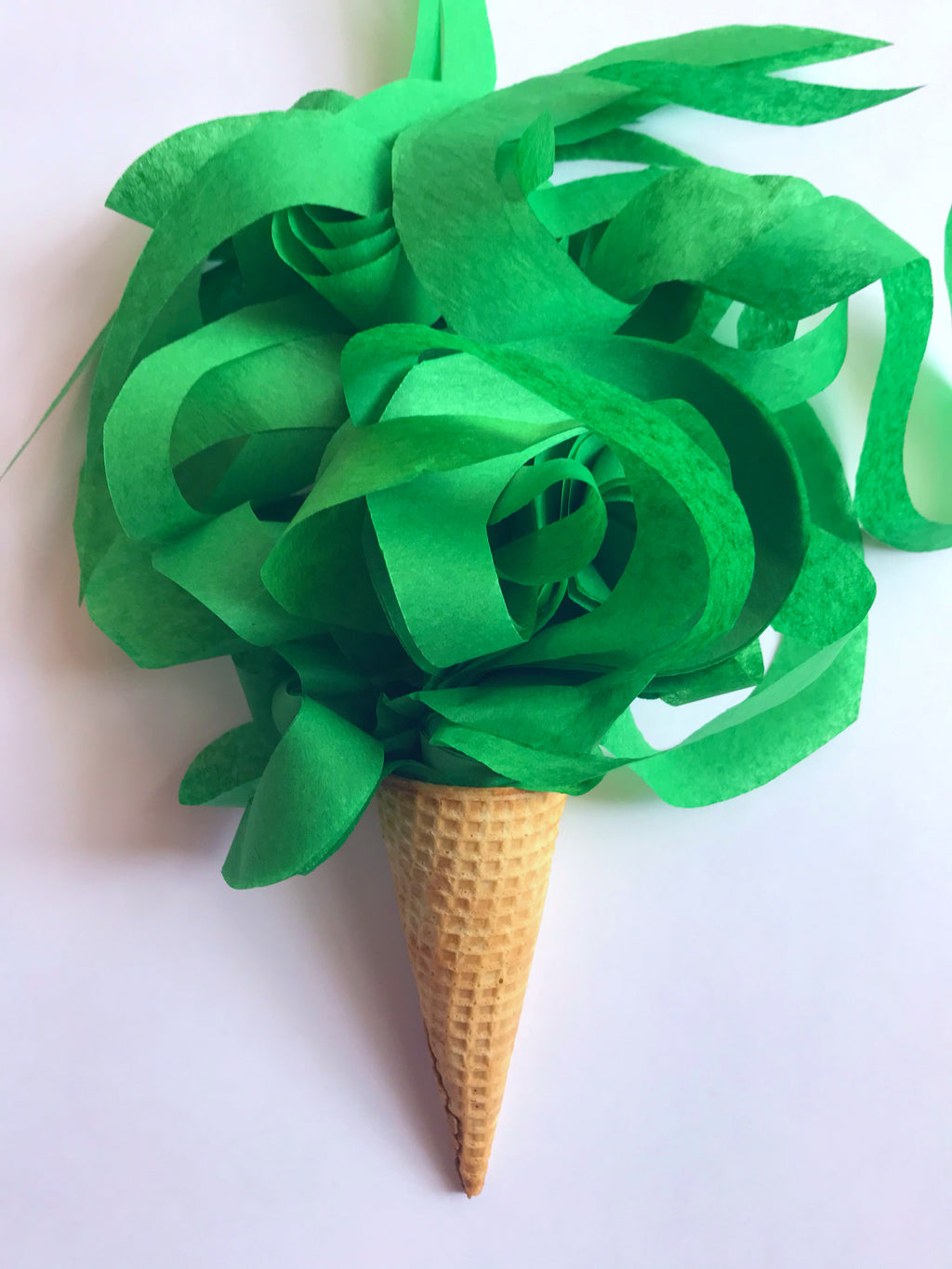 Green festive curly tissue paper toss made from 100% premium recycled fibers