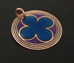 Copper pendant with the quatrefoil design.