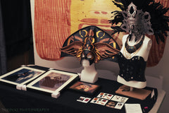 Display table with masks and photos