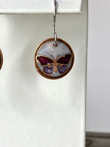 Small White and Purple Butterflies in Copper