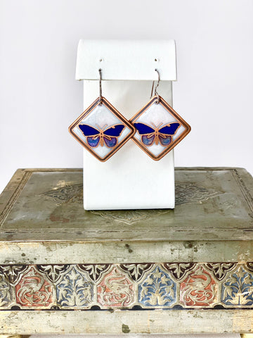 Blue Butterfly Earrings with a White Background in Copper
