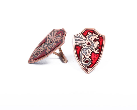 Copper shield flying dragon cufflinks with red inlay
