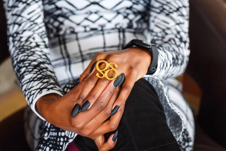 Model Wearing Dalasini Gold Monogram Ring