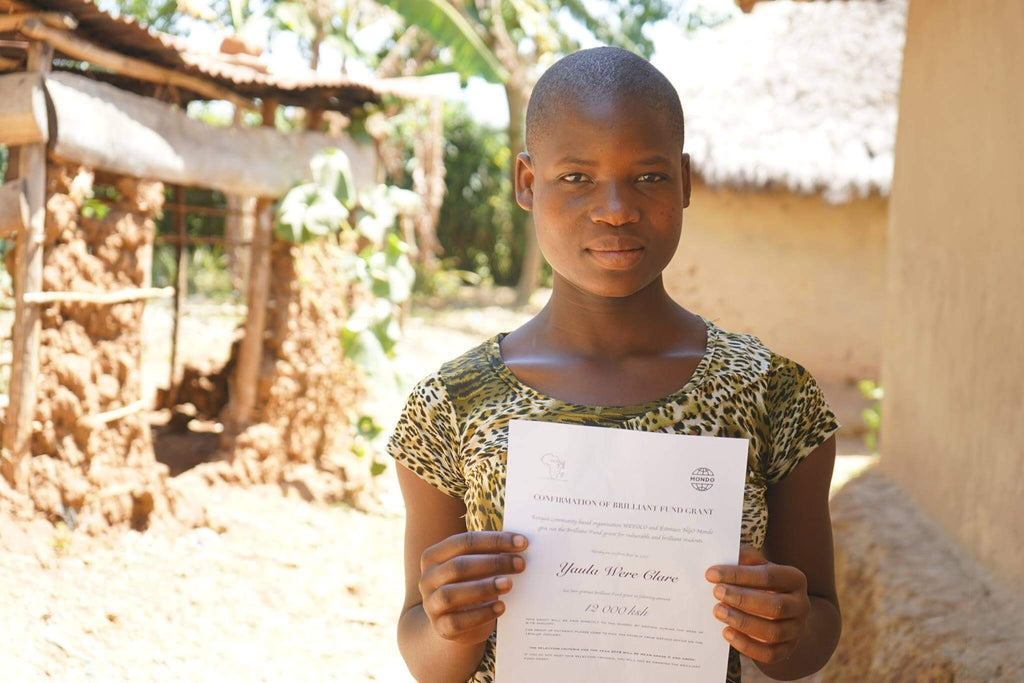 child in Kenya with school diploma, Bold Tuesday and Mondo charity