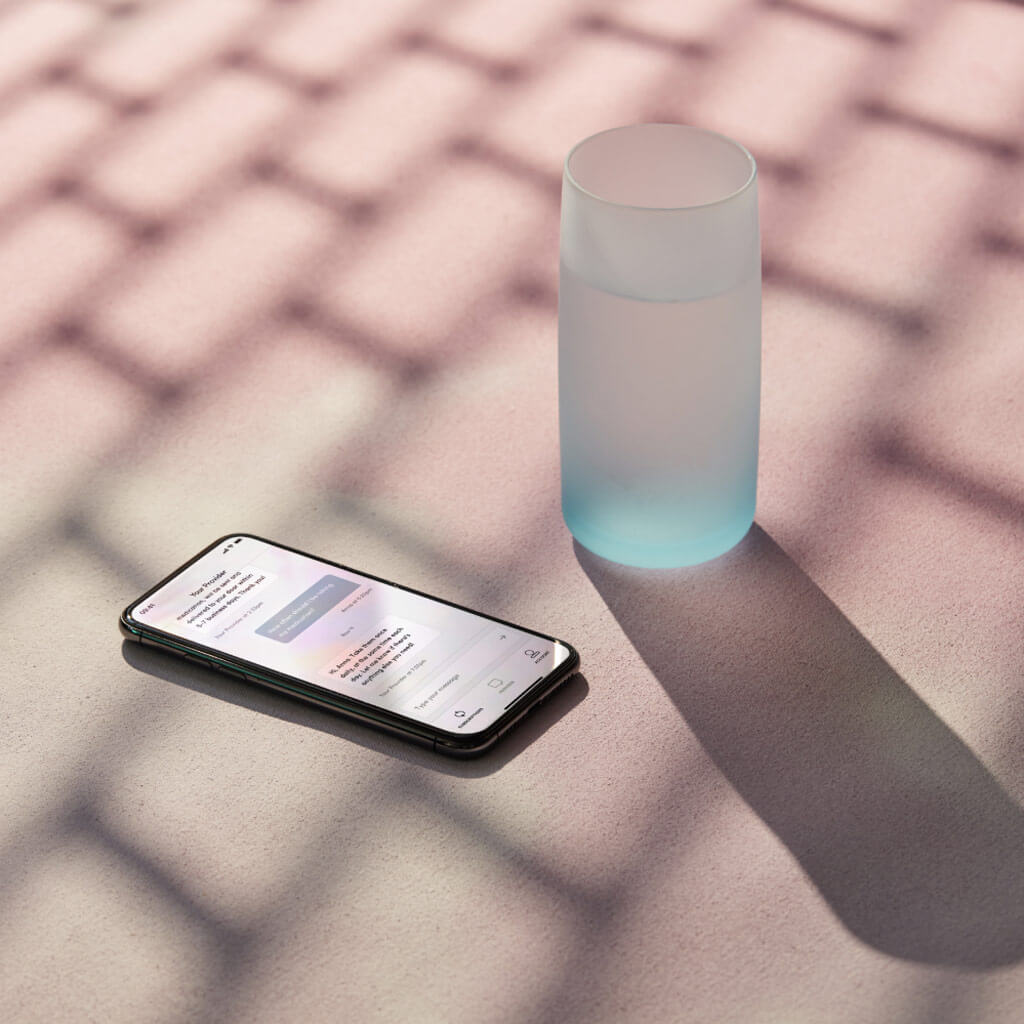 smartphone with glass of water