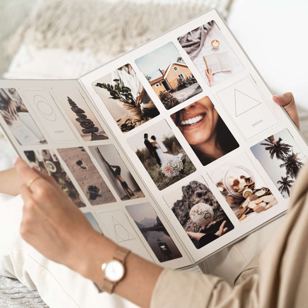 Woman holding vision board covers in lap