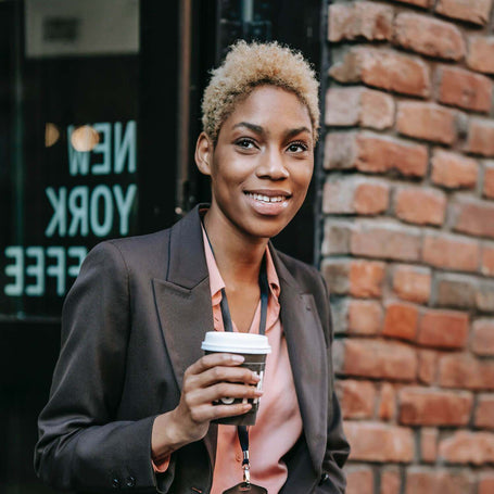 Black woman in New York with a coffee