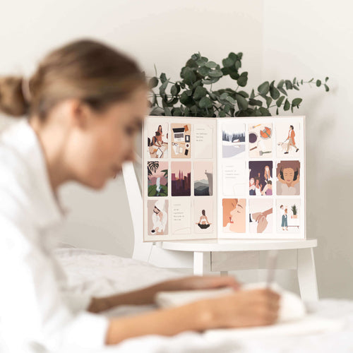 Vision board in bedroom with a woman