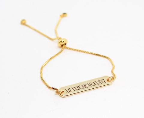 Sabina Motasem, modern minimalist British bridal designer on the best presents for your bridal party gold bracelet
