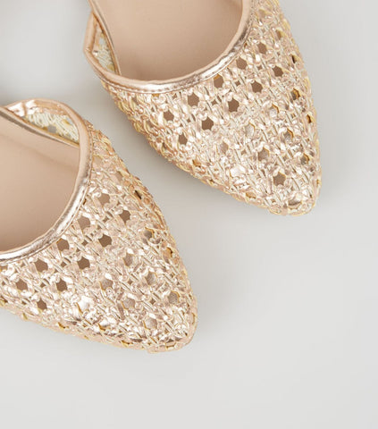 Sabina Motasem, modern minimalist British bridal designer on the best presents for your bridal party gold shoes