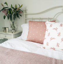 dusky pink hare and star design cushions