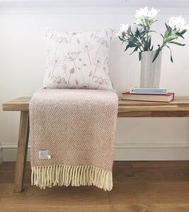 dusky pink meadow flower cushion and dusky pink blanket