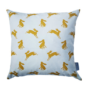 Cushion with mustard yellow hare design