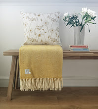 mustard meadow flower cushion and yellow blanket