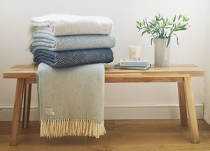 pile of blue wool blankets, duckegg, navy, petrol and silver grey