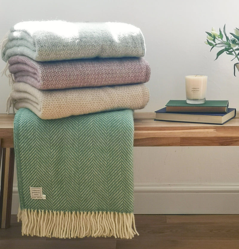 wool blankets in grey green, heather, oatmeal and sea green