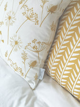 mustard flowers and wishbone print cushions