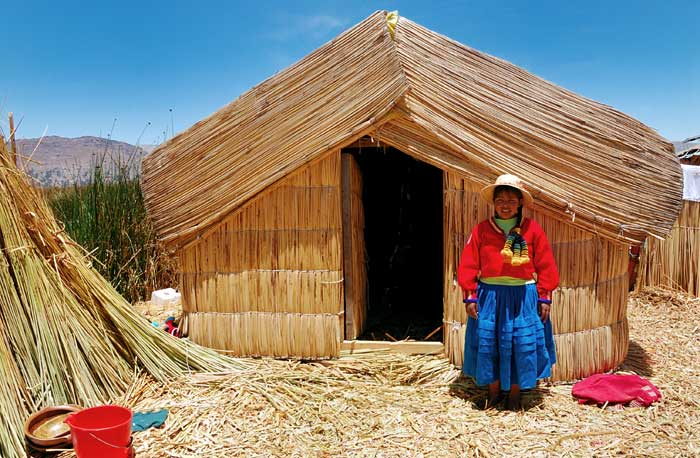 Peruvian Pom Poms: A Native Girl Wearing Traditional Costume on the Islands of Uros