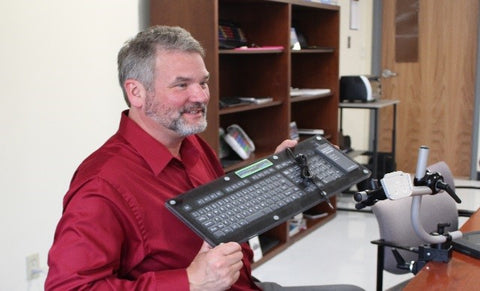 Glen Dobbs demonstrating the new waterproof keyboard with the EASTCONN Assistive Technology team