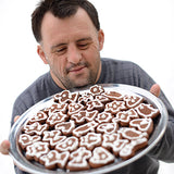 Man with Down Syndrome presenting a platter of gingerbread cookies