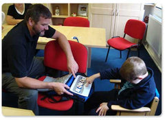 Glen showing the LoganProxTalker to a student