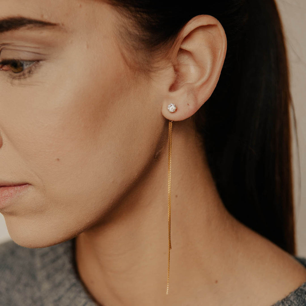 Model wearing our large Rolo Chain CZ Studs in 14k gold filled.