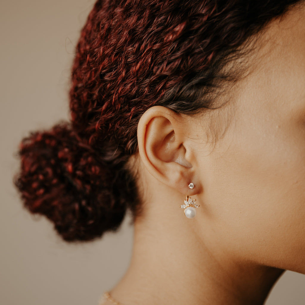 Image of the model wearing the CZ/ Pearl Ear Jacket Earrings in gold.
