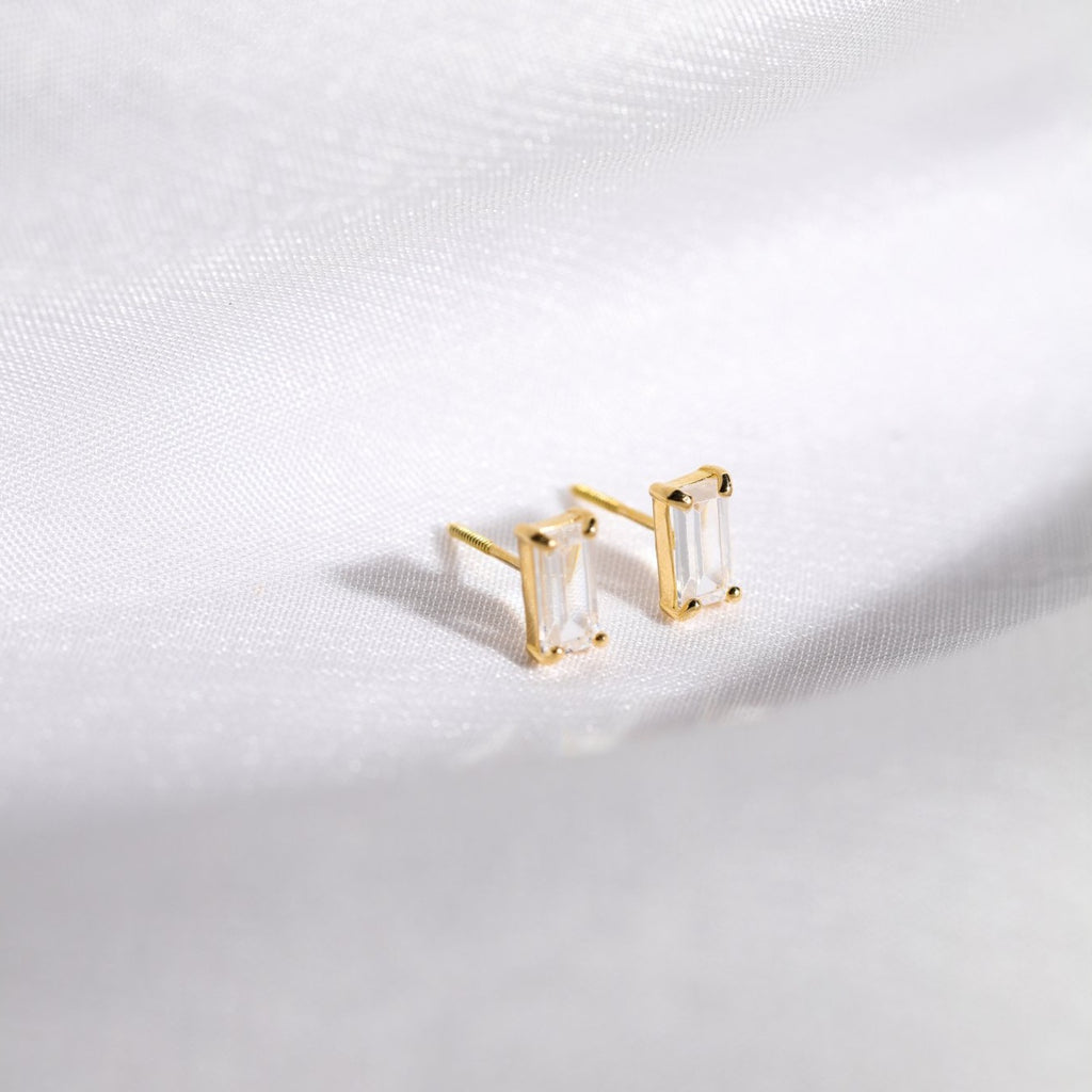 Image of our 10k Solid Gold Emerald CZ Studs in yellow gold.