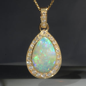 Natural opal ice 18k gold pendant