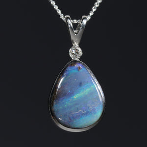 Natural opal with two freckles