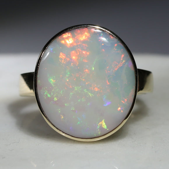 Large White Opal with Bright Flashes of Yellow, Green and Red Gold Ring - Size 7.5