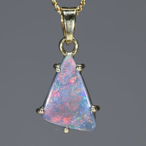 Semi Black Opal 18k pendant with flashes of red and pink