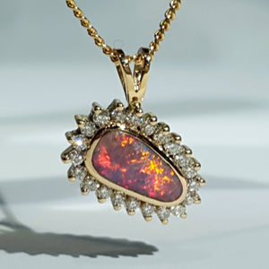 Natural opal camp fire 18k gold pendant
