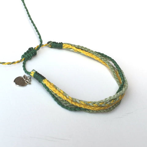 Green and gold friendship bracelet, team spirit